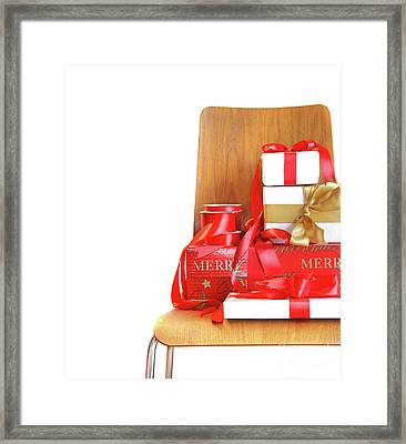Pile Of Gifts On Wooden Chair Against White Framed Print by Sandra Cunningham