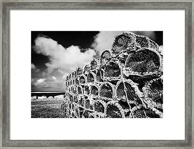 Pile Of Lobster Pots Stacked In The West Coast Of Ireland Framed Print