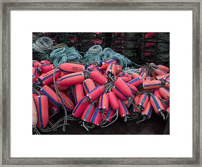 Pile Of Pink And Blue Buoys Framed Print by Carol Leigh