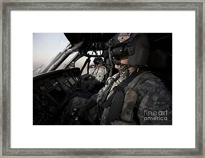 Pilot In The Cockpit Of A Uh-60l Framed Print by Terry Moore
