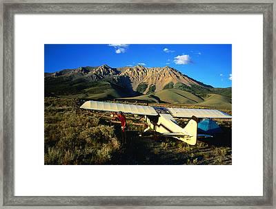 Pilot Of Ultralight Plane Taking Camping Excursion, Near Borah Peak, Idaho, United States Of America, North America Framed Print by Holger Leue