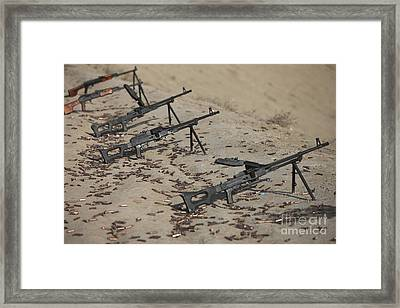 Pk Machine Guns And Spent Cartridges Framed Print by Terry Moore