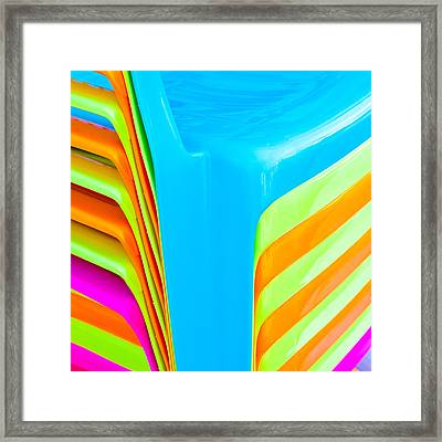 Plastic Chairs Framed Print