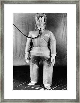 Plastic Protective Outfit Filled Framed Print by Everett
