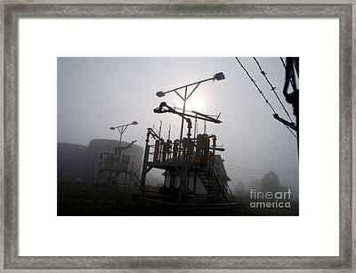 Platforms And Tanks At Petrocor In The Fog Framed Print by Gary Chapple