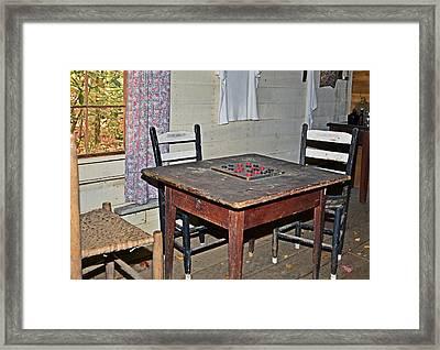 Playing Checkers Framed Print by Susan Leggett