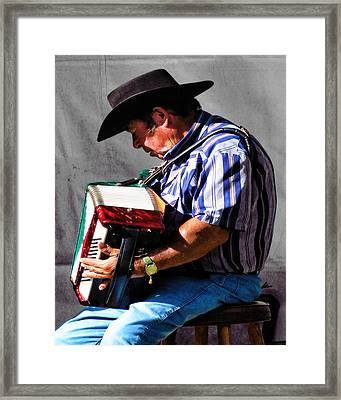 Playing For Taos Framed Print by Terry Fiala