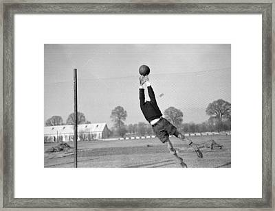 Playing In Goal Framed Print by Kurt Hutton
