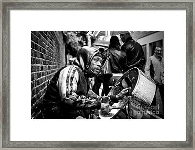 Playing In The Rain Framed Print by Donald Davis