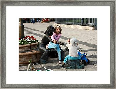 Playing On Sculpture Framed Print by Sally Weigand