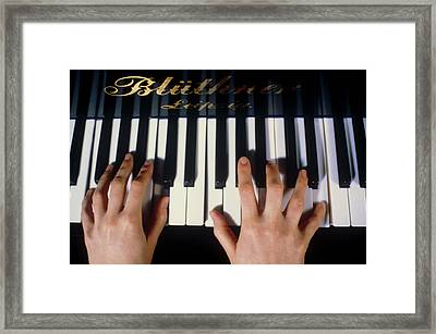 Playing The Piano. Framed Print