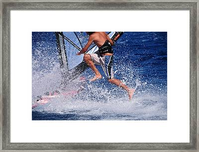 Playing With The Waves Framed Print by Manolis Tsantakis