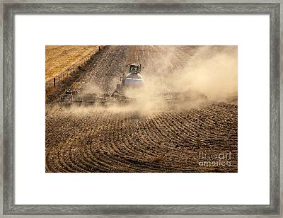 Plowing The Ground Framed Print by Mike  Dawson