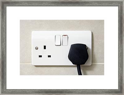 Plug In An Electric Wall Socket Framed Print