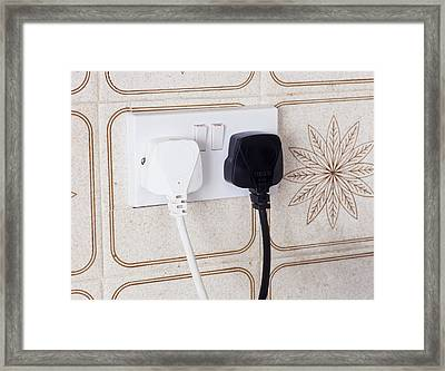 Plugs In Sockets Framed Print