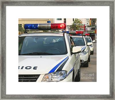 Police Action Framed Print by Yali Shi