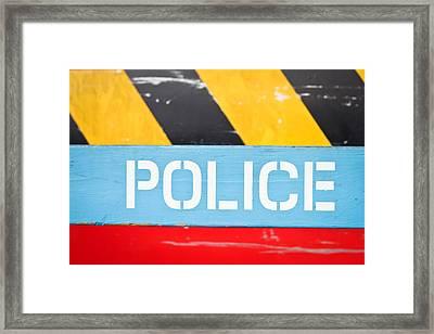 Police Framed Print by Tom Gowanlock