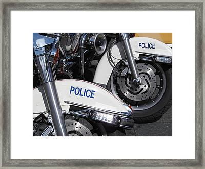 Police Wheels Framed Print by Alfred Ng