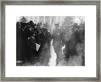 Policeman Leads An Arrested National Framed Print by Everett