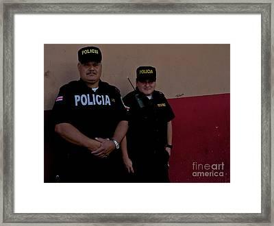 Policia Framed Print by Sean Stauffer