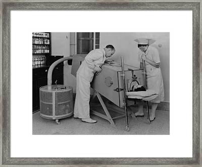 Polio Patient In An Iron Lung Framed Print by Everett