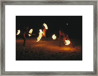 Polynesian Dancers Put On A Traditional Framed Print by Tim Laman