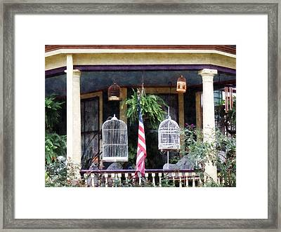 Porch With Bird Cages Framed Print by Susan Savad