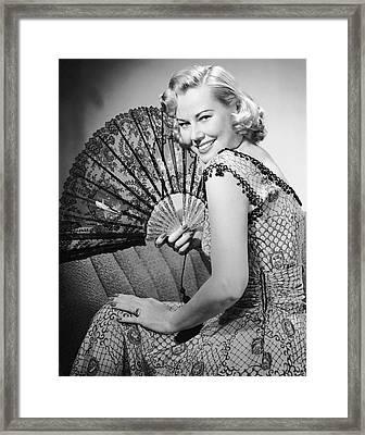 Portrait Of Blonde Woman Holding Fan Framed Print by George Marks