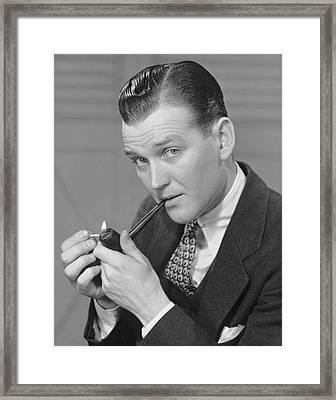 Portrait Of Businessman Lighting Pipe Framed Print by George Marks