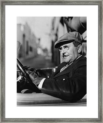 Portrait Of Man In Drivers Seat Of Car Framed Print by Everett