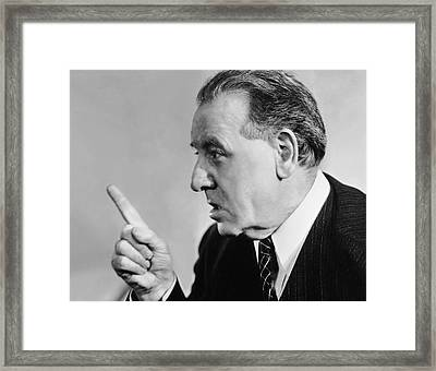 Portrait Of Mature Man Speaking With Authority Framed Print by George Marks