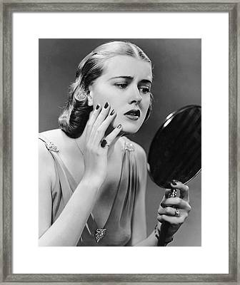Portrait Of Upset Woman Looking In Hand Mirror Framed Print by George Marks