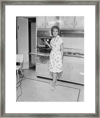 Portrait Of Woman Cooking In Kitchen Framed Print by George Marks