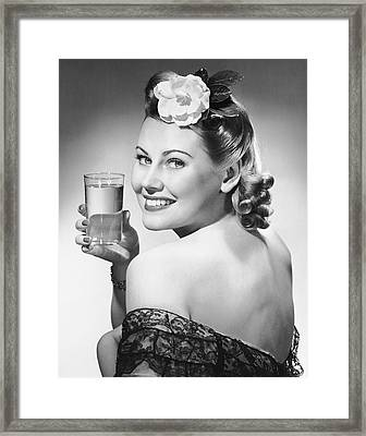 Portrait Of Woman Holding Glass Of Water Framed Print by George Marks