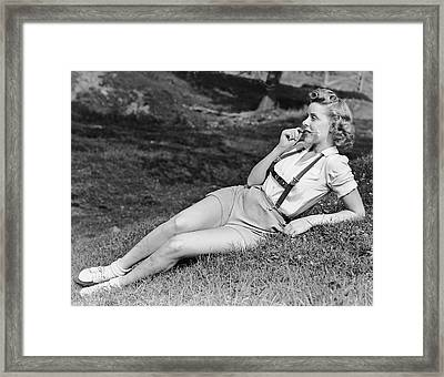 Portrait Of Woman In With Flower In Mouth Framed Print by George Marks