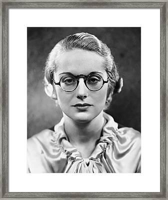 Portrait Of Woman Wearing Eyeglasses Framed Print by George Marks