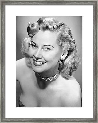 Portrait Of Woman Wearing Pearl Necklace Framed Print by George Marks