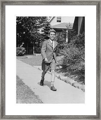 Portrait Of Young Boy (12-13) Walking Along Sidewalk Framed Print by George Marks