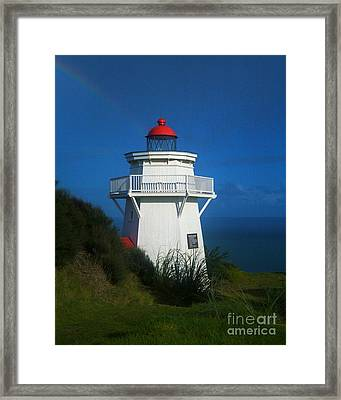 Framed Print featuring the photograph Pouto Lighthouse With Rainbow New Zealand by Mark Dodd