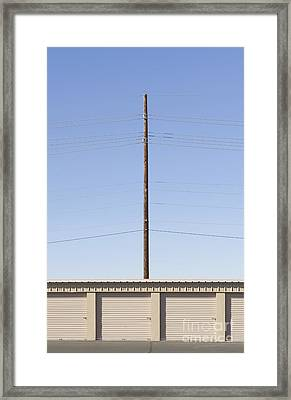 Power Line Pole Over Bay Doors Framed Print by Dave & Les Jacobs