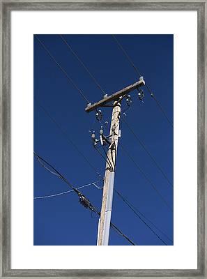 Power Lines Against A Clear Sky Framed Print by John Burcham
