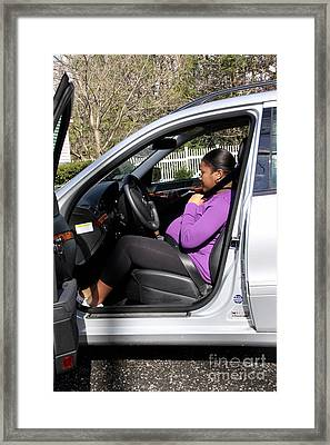 Pregnant Woman Putting On Seatbelt Framed Print