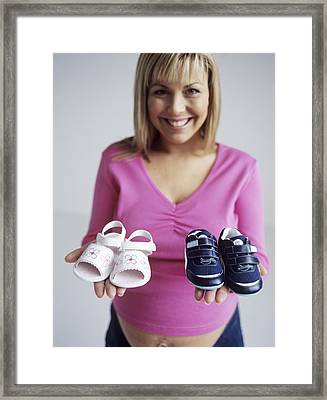 Pregnant Woman With Baby Shoes Framed Print