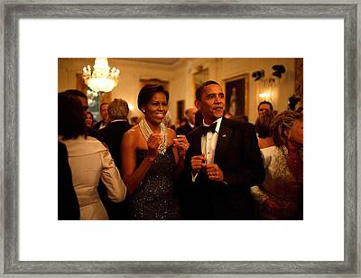 President And Michelle Obama Applaud Framed Print
