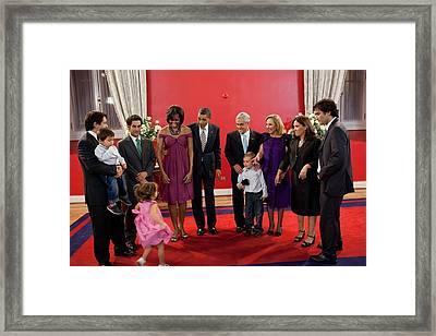 President And Michelle Obama Gather Framed Print