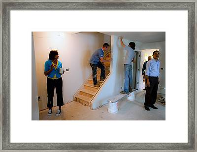 President And Michelle Obama Help Paint Framed Print by Everett