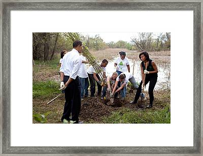 President And Michelle Obama Help Plant Framed Print
