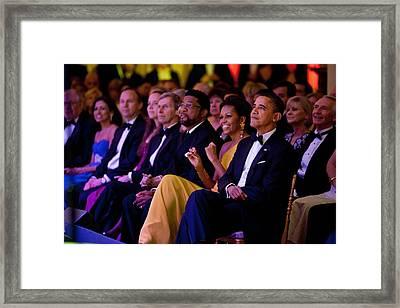 President And Michelle Obama Listen Framed Print by Everett