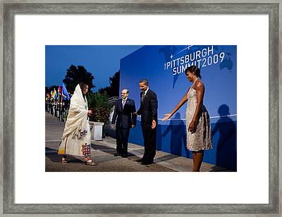 President And Michelle Obama Receive Framed Print by Everett