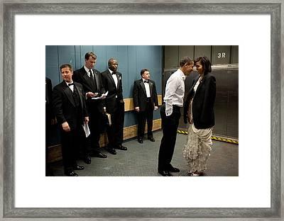 President And Michelle Obama Share Framed Print